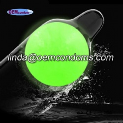 Glowing enlargement bead condom